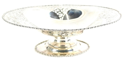 A George V silver dish, of shaped oval form, with part pierced body, on a squat stem and oval foot, London 1915, 28cm wide, 16oz.
