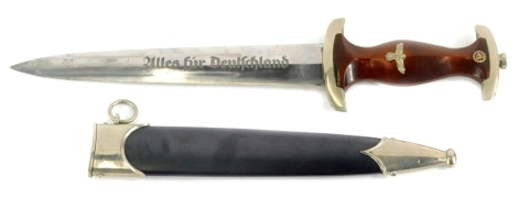 A Third Reich SA dagger, with emblem and eagle mounts to wooden handle, the blade stamped Alles Fur Deutschland and the maker Herman Konejung Solingen, with metal scabbard, 37cm long.