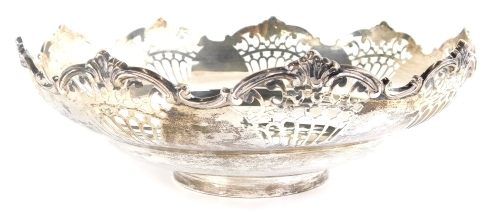 A George V silver dish, of flared form, partially pierced, on circular foot, Sheffield 1920, 23cm wide, 13oz.
