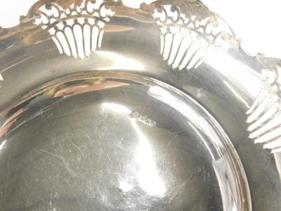A George V silver dish, of flared form, partially pierced, on circular foot, Sheffield 1920, 23cm wide, 13oz. - 2