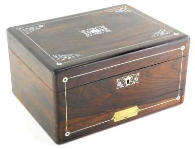 A rosewood and mother of pearl inlaid box, of rectangular form, the hinged lid revealing a leather section with a removable shelf and deep well beneath, the front drawer with a flush brass handle, 17cm high, 32cm wide, 23cm deep.