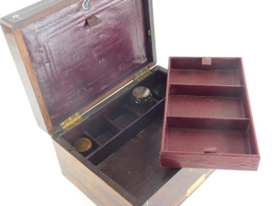 A rosewood and mother of pearl inlaid box, of rectangular form, the hinged lid revealing a leather section with a removable shelf and deep well beneath, the front drawer with a flush brass handle, 17cm high, 32cm wide, 23cm deep. - 2