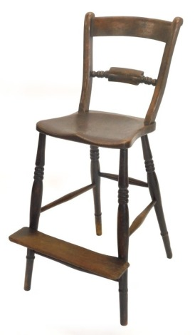 A 19thC Oxfordshire ash and elm bar back adult sized highchair, with turned legs and foot platform, stamped to the seat rail EB.
