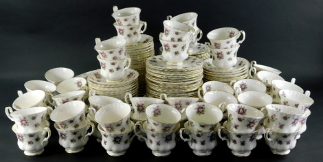 A comprehensive Royal Albert Sweet Violet pattern bone china part tea service, to include sixty cups, sixty saucers, sixty tea plates and side plates, 15cm diameter, printed marks beneath. (a quantity)