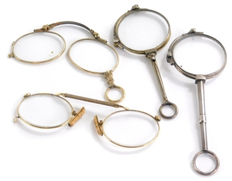 A small collection of lorgnette, to include three examples, each with gold coloured metal frames and a silver mounted piece. (4)