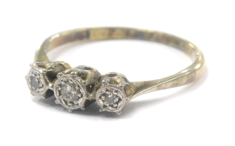 A three stone diamond ring, with illusion setting in 18ct gold, 1.7g all in.