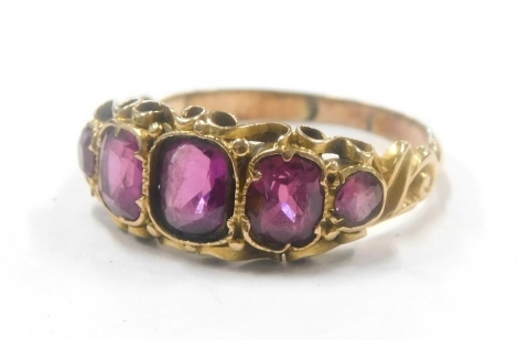 A yellow metal dress ring, set with five facet cut amethyst, unmarked.