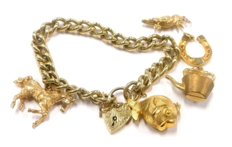 A 9ct gold curb link chain, mounted with a 9ct gold horse shaped charm, and four further 9ct gold charms, 49.9g all in.
