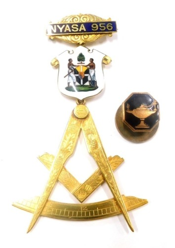 A Masonic jewel, the top bar marked NYASA 956, with enamel decorated shield of two figures, marked to reverse Chancellor Dublin, and stamped 15ct, with a lower Masonic emblem, inscribed WOR BRO F.A.Usher R.W.M 1921, from the Bretheren of Lodge Nyasa numbe