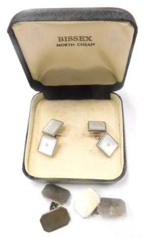 Two pairs of cufflinks, to include a pair of silver engine turned design cufflinks, in fitted case, 12.2g all in, together with a set of mother of pearl and silver plated Bissex cased cufflink's. (2 boxes)