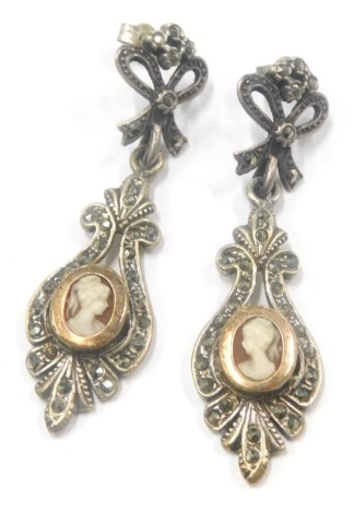 A pair of marcasite drop earrings, each with bow design top with floral drop with central oval panel depicting figure, with silver gilt borders, 4.5cm high, 7.4g all in. (2)