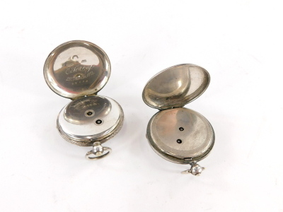 Two silver fob watches, to include a Port House London silver cased pocket watch, and a Victorian silver pocket watch bearing the inscription E Terry 29th March 1814, key wind, 92.8g all in. (2) - 2