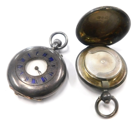 A silver fob watch, with outer case marked with blue enamel Roman numerals, and bearing figure of a stag to reverse, 43g, together with a silver sovereign case, Birmingham, circa George V, 30.3g all in. (2)