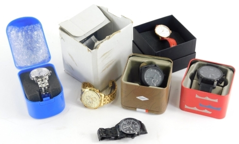 A group of fashion watches, to include a Tissot gentlemans wristwatch, a Guess gentlemans wristwatch, a Karl Von Zeytyn wristwatch on red leather strap, two Fossil wristwatches and a gentlemans Citizen Phonograph. (1 tray)