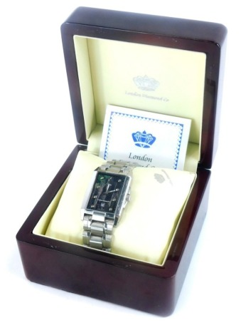 A London Diamond Company gentlemans wristwatch, with rectangular dial on a black lustre finish with inset stones, on stainless steel bracelet, with certificate, boxed.