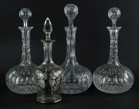 A set of three early 20thC cut glass decanters, each with orb stoppers and bulbous bodies, and another decanter with associated cut glass stopper, 25cm high.