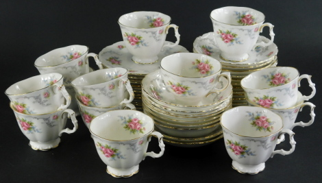 A Royal Albert Tranquility pattern part tea service, comprising twelve tea cups, thirteen saucers, tea plates and cereal bowls, 14cm wide, printed marks beneath and a Royal Kent cup and saucer. (a quantity)