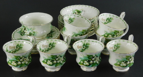 A Royal Albert Flowers of the Month May pattern part tea service, to include eight cups, cereal bowl, sugar bowl, side plates, 15cm wide, etc. (a quantity)