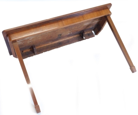 A mahogany folding table, the rectangular crossbanded top above a plain frieze on two hinged square tapering legs to the front and two removable legs to the reverse, 19thC but adapted, 124cm wide, 51cm deep, (AF).