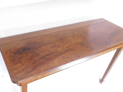 A mahogany folding table, the rectangular crossbanded top above a plain frieze on two hinged square tapering legs to the front and two removable legs to the reverse, 19thC but adapted, 124cm wide, 51cm deep, (AF). - 2
