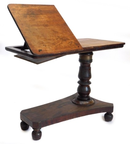 An early Victorian mahogany adjustable reading table, the rectangular top with a part hinged and ratcheted section, on adjustable turned column and concave platform base with bun feet, (AF), 94cm wide.