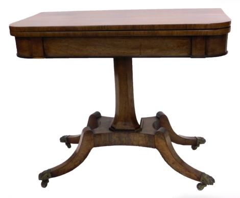 A George IV rosewood card table, the rectangular top with rounded top enclosing a baize lined interior, on a chamfered tapering column with concave platform and splayed legs with brass castors, 92cm wide.