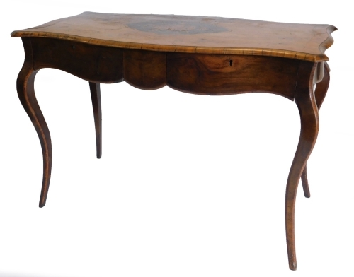 A 19thC walnut library table in French style, the shaped rectangular top with a central marquetry cartouche of flowers on an ebony ground, within tulipwood crossbanded borders, above two frieze drawers on crossbanded cabriole legs, 71cm high, 105cm wide,