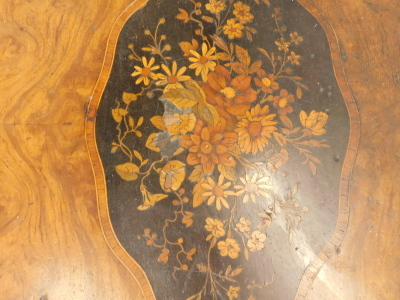 A 19thC walnut library table in French style, the shaped rectangular top with a central marquetry cartouche of flowers on an ebony ground, within tulipwood crossbanded borders, above two frieze drawers on crossbanded cabriole legs, 71cm high, 105cm wide, - 2