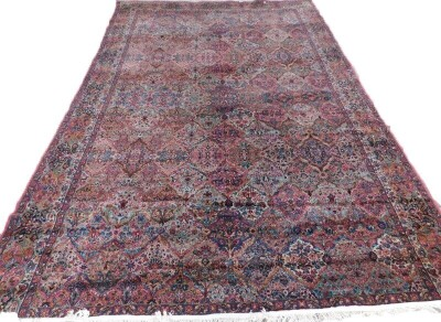 A Bakhtiari carpet, decorated with multi-coloured panels of flowers etc, with one wide, two narrow borders 510cm x 350cm.