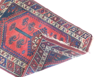 A Persian rug, with a pole medallion on a red ground with one wide and one narrow border. - 3