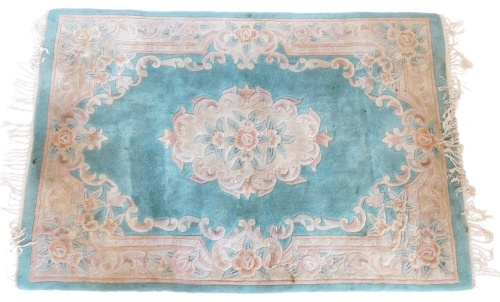 A Chinese rug, with a green ground, decorated in Aubusson style, 180cm x 120cm.