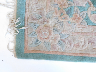 A Chinese rug, with a green ground, decorated in Aubusson style, 180cm x 120cm. - 2