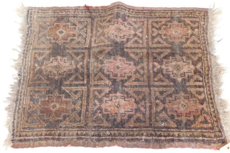 A small Turkish or Afghan mat, with a design of nine medallions, in red, on a brown ground, (AF), 55cm x 47cm.
