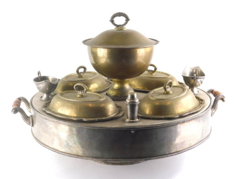 A 20thC silver plated hot plate stand, of circular form, centred by a removable bowl, with four entree dishes, two sauce boats and two pepper pots on a circular foot, with turned handles beaded outline and internal water heater, 74cm wide.