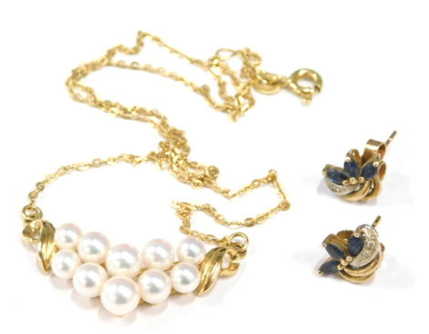 Two items of jewellery, to include a pair of 9ct gold floral scroll earrings, each set with cz and blue stones. 1.6g, together with a cultured pearl necklace, the clasp marked 750. (2)