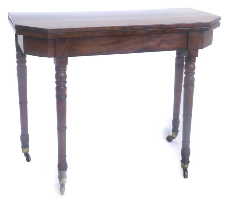 A 19thC mahogany card table, the rectangular top with canted front corners above a plain frieze with ebony stringing on turned tapering legs with castors, (AF), 89cm wide.