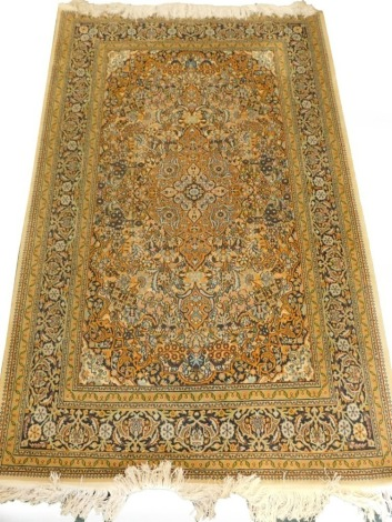 A Persian type mercerised cotton rug, with a central medallion, surrounded by an all over pattern of flowers, leaves, etc., one wide and various narrow borders, 201cm x 124cm.