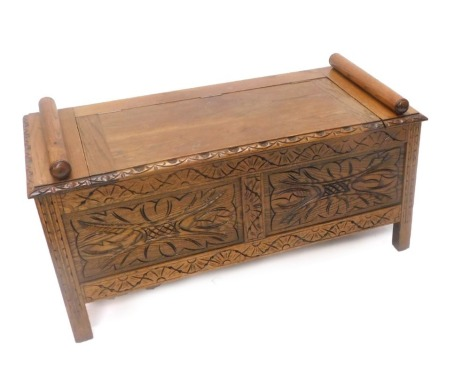 An early 20thC carved oak hall bench, with hinged lid, panel front on stiles, 104cm wide.