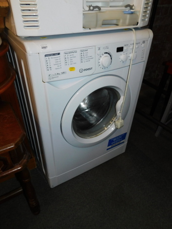 An Indesit A Plus 8kg washing machine, model EWD 81482.
