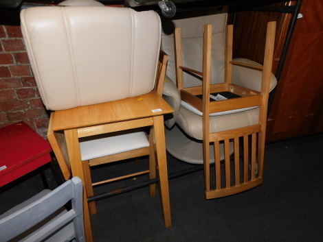 A cream leather reclining armchair and footstool, together with a table and two chairs. (5)