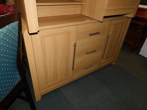 An oak effect sideboard with steel handles.