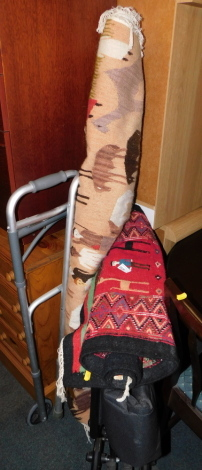 Two rugs, a wheel chair and a zimmer frame. (4)