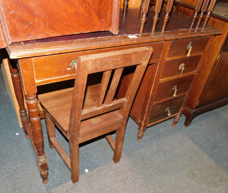 An early 20thC mahogany desk, together with a chair. (2)