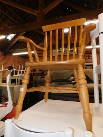 A beech fireside kitchen armchair.