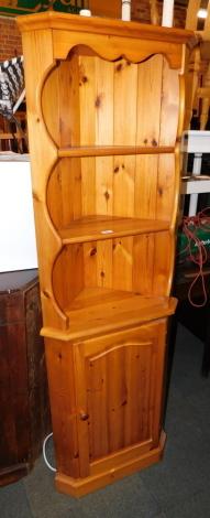 A pine corner cabinet.