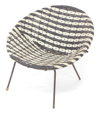 A 1960's plastic woven child's chair, with black metal base, in the manner of Conran.