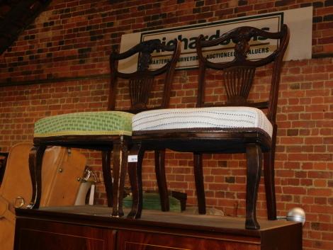 A pair of Edwardian mahogany nursing chairs.