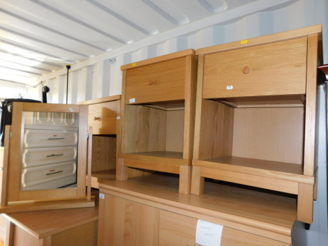 Three beech and oak veneered bedside cabinets, together with a matching mirror. (4) NB. We have specific instructions from vendor to sell WITHOUT RESERVE.