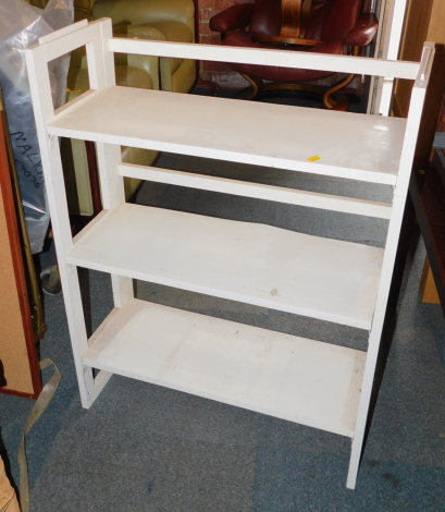 A painted folding bookcase.