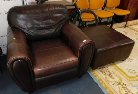 A brown leather armchair, together with a matching pouffe. (2)